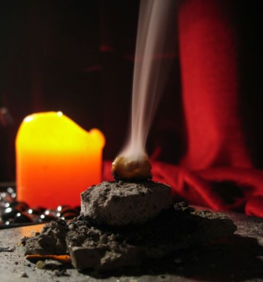 frankincense resin burning on charcoal