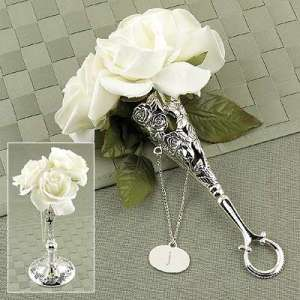 white rose tussy mussy in a Victorian silver tussy mussy holder